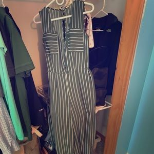 Long green jumpsuit with white stripes and belt